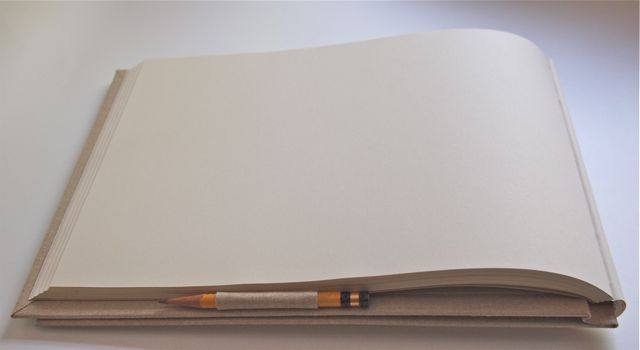 blank book with a built in pencil holder